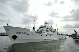 U.S. Coast Guard still protects Vietnamese fishermen from Chinese ships such as this one leaving the Xingang Port of Haikou on March 26.