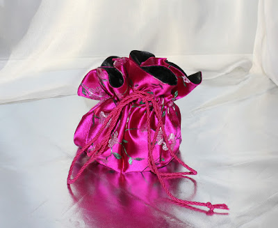 http://s1197.photobucket.com/user/avstar/media/Jewellery%20pouch/pouch16.jpg.html