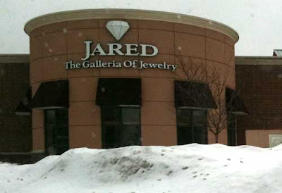 Photo of the entrance of Jared The Galleria of Jewelry, with a white diamond logo above the name