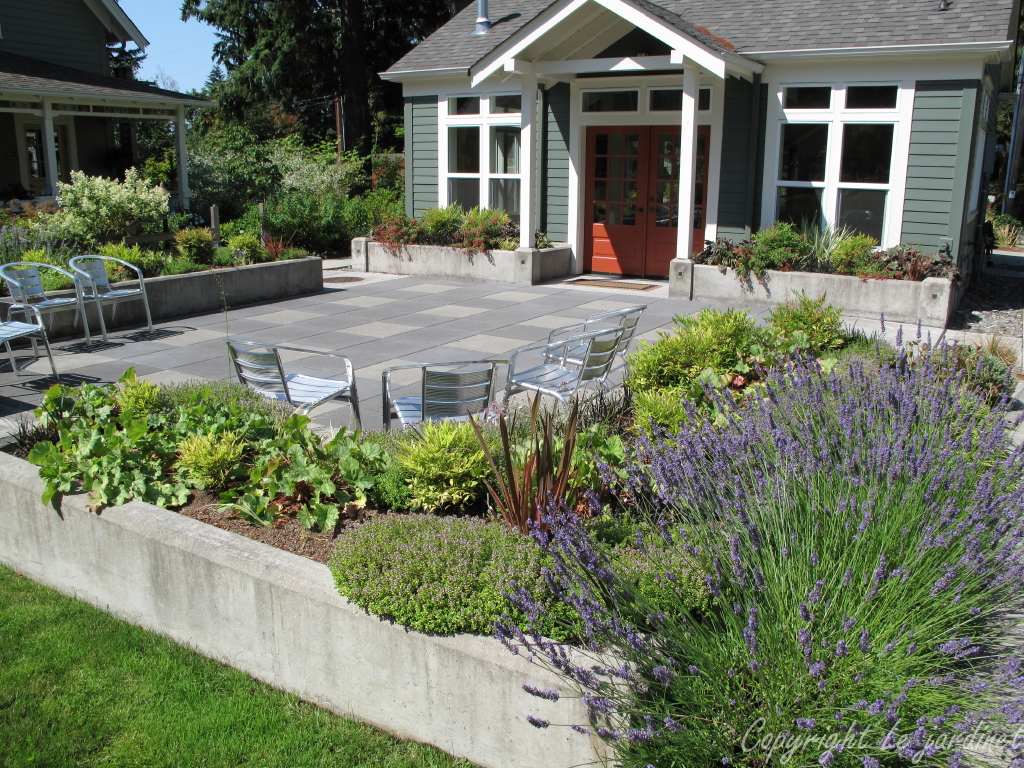 A Simple Raised Border Around This Concrete Paver Patio Creates A Welcoming  Space For This Community Center.