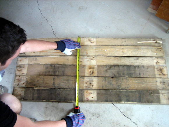 Step three for your DIY pallet sign: measure the wood layout to know the exact size of the sturdy backing pieces you need.