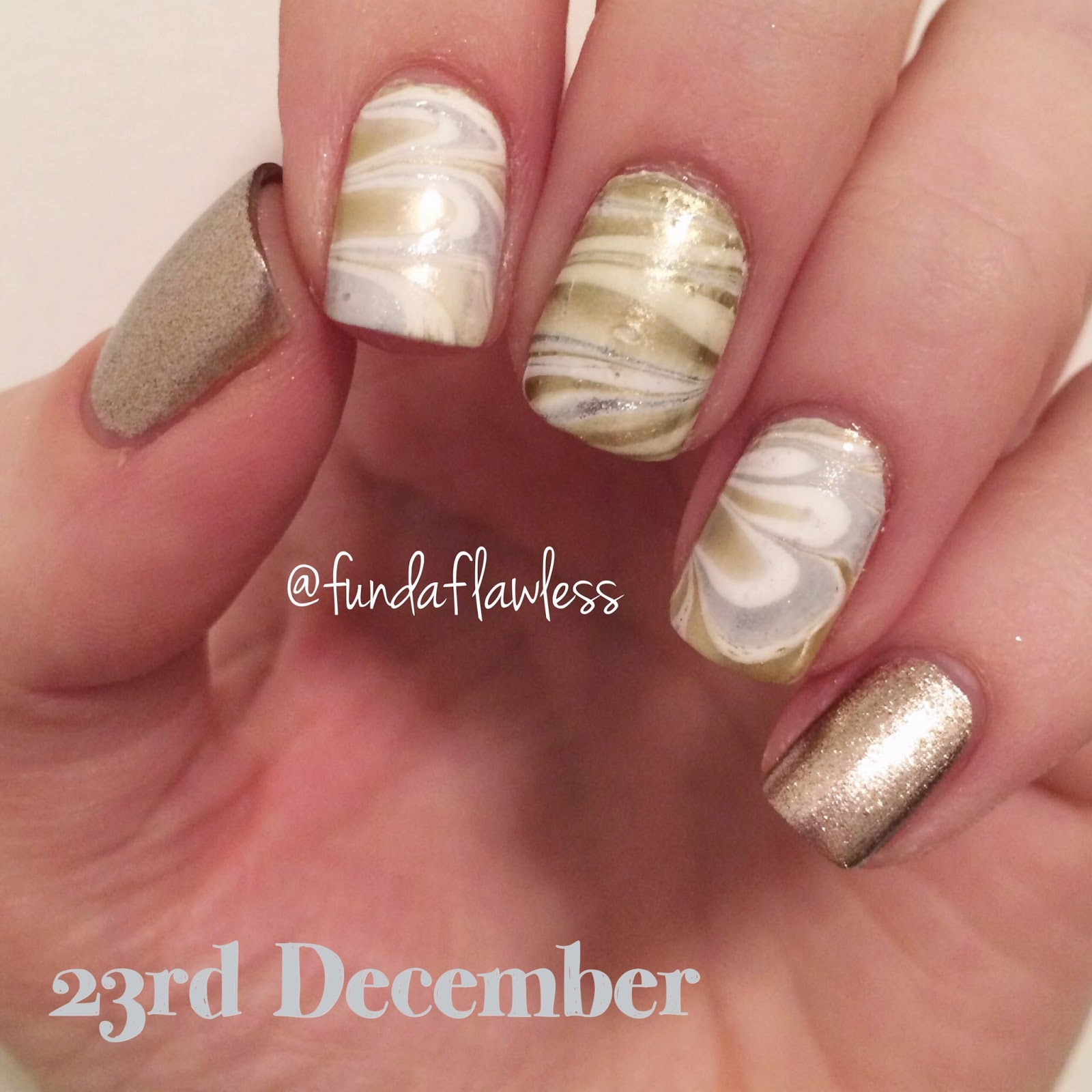 Gold and silver watermarble nail art