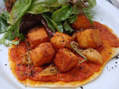 Flatbread with grilled peaches and haloumi at Oleana, Cambridge, Mass.