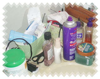 Bathroom Sink piled with health and beauty products