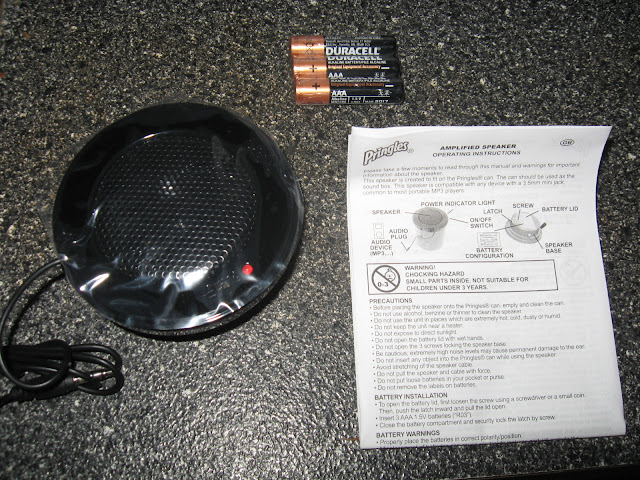 The speaker gadget, 3 AAA batteries, and the instructions