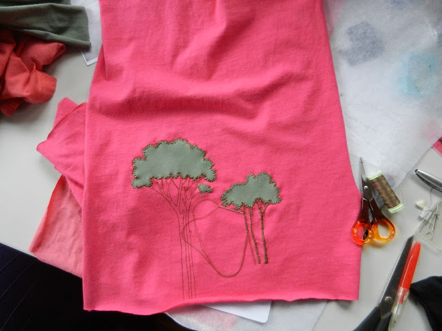 appliqued and embroidered trees on a t-shirt