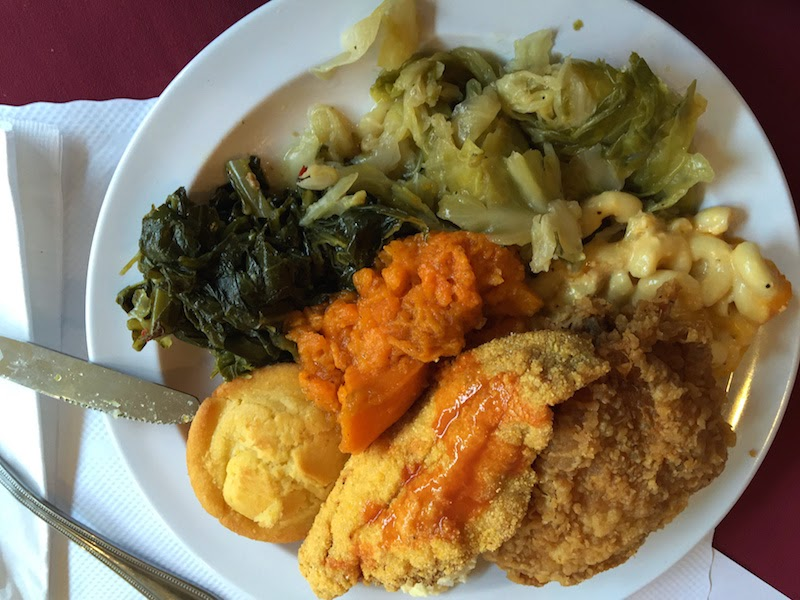 Fried catfish, fried chicken, yams, and greens at Souls Restaurant's Sunday dinner buffet in Oakland, CA