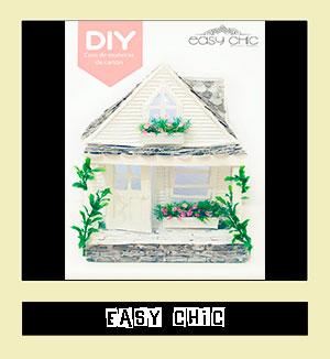http://easychicmanualidades.blogspot.com.es/2014/08/como-hacer-una-casa-de-munecas-de-carton.html