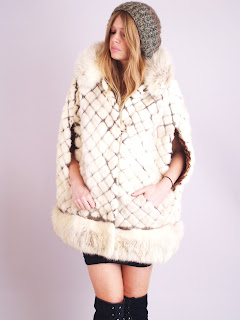 Vintage 1960's white mink fur cape with diamond pattern design and front pockets.