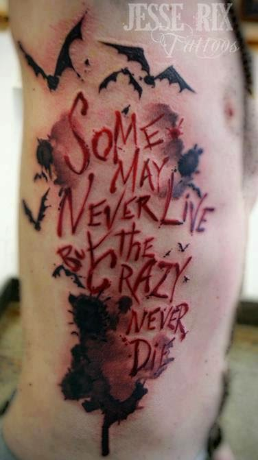 Some may never live but the crazy never die quote tattoo on side body
