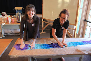 Kim and Sarah scrubbing and fulling a nuno-felted scarf