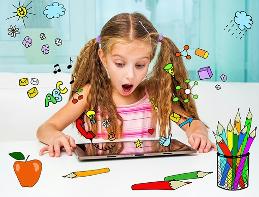 A girl in awe of the tablet she is using in her class.