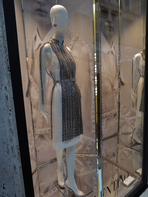 Window display of Valentino in Rome City - mannequin wearing monochrome dress