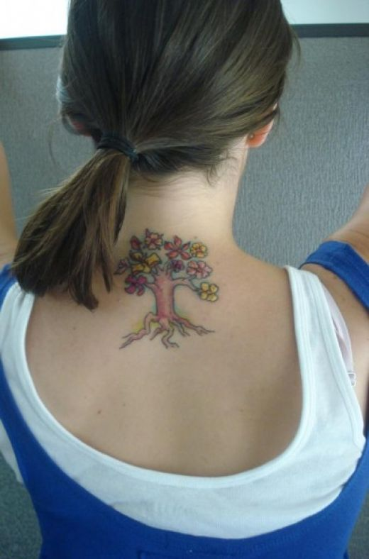 tattoos on back of neck. I dunno whether I like this one or not, a tree tattoo for back of neck