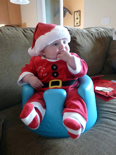 Freddie Claus sitting in his Bumbo