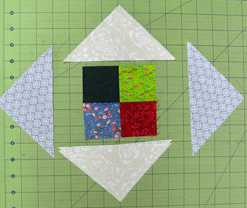 Add the pieces to the 4 square blocks