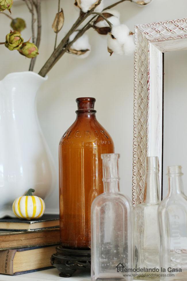 vintage Amber Clorox bottle, pumpkins, clear bottles, old books