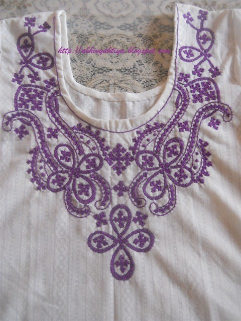sindhi embroidery design on suit neck