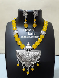 A Yellow colour Glass Beads Necklace with German Silver Pendant and Beautiful earrings