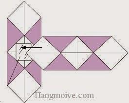 Bước 6: Gắn, dán hai tờ giấy thành hình chữ thập.