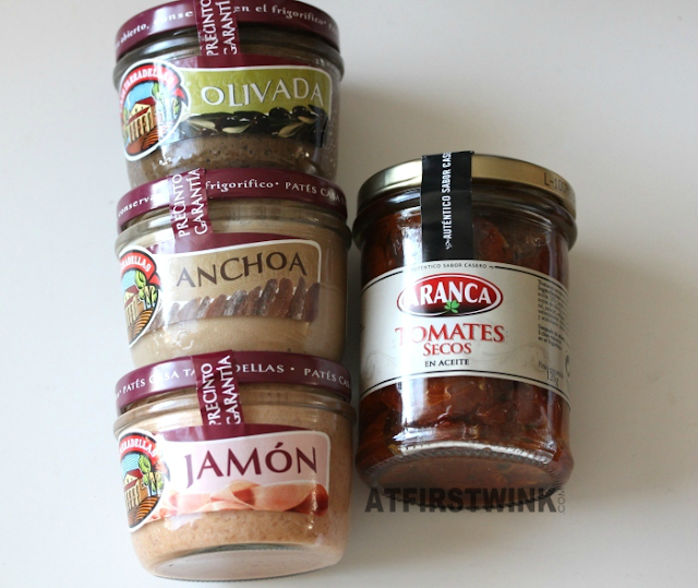 Barcelona souvenirs: casa taradellas glass jars pate olives, anchovis, and jamon ham & aranca dried tomatoes