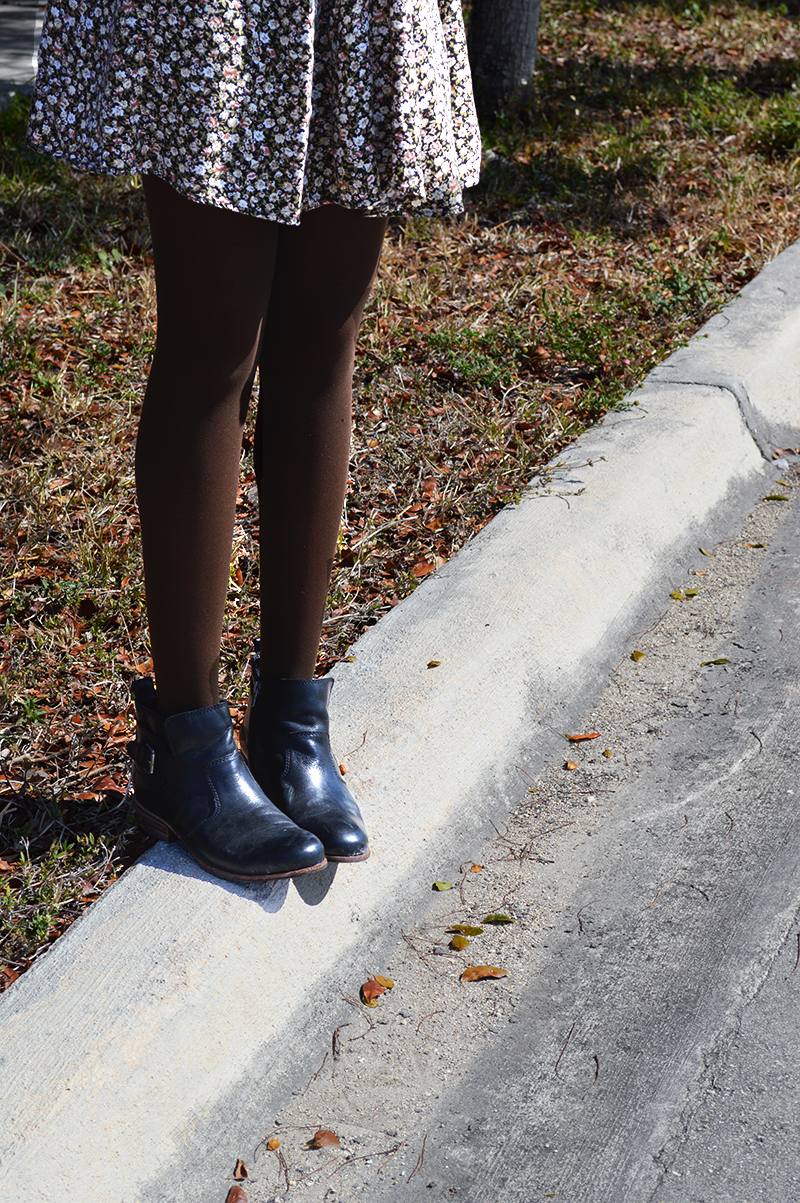 Fashion Blogger Anais Alexandre of Down to Stars wearing a vintage dress and dolce vita boots
