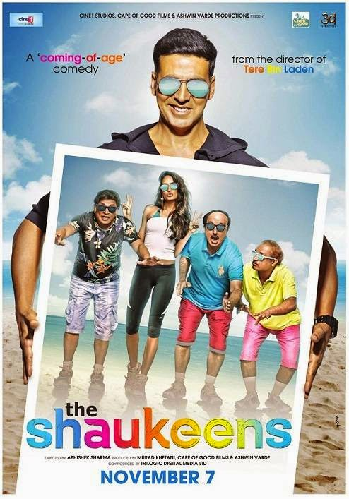 Akshay Kumar showing the poster of Lisa Haydon, Anupam Kher, Annu Kapoor and Piyush Mishra in The Shaukeens movie poster