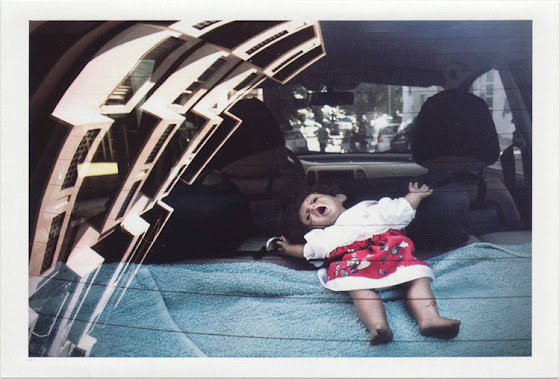 dirty photos - Once - street photo of scared doll inside car and reflection