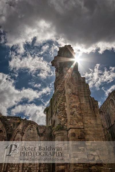 Sun peeping round tower adjusted