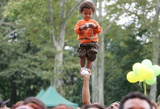 funny picture: child lifted into the air on a hand