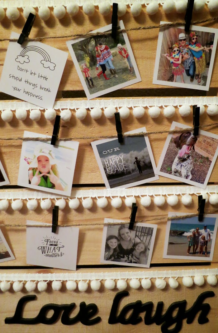 clothes pins and pom poms for displaying pictures