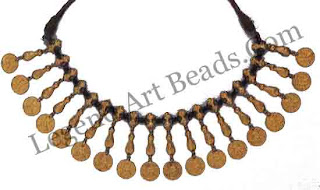NECKLACE OF COINS Andhra Pradesh 19th century a typical Muslim ornament in the area, each gold coin is stamped with a male face.