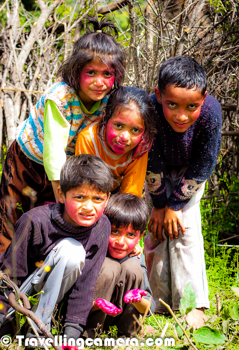 After so many year, I moved towards hills to celebrate the festival of colors - Holi. Initially decided plan was different and finally it was exactly opposite. Let's check out this Photo Journey to know more about the planned Holi and final thing which happened...These are the kids I met on the special day of Holi and everyone of them was very cheerful, as you can see in the photographs. These kids belong to a village called Kehlwin, which is in Una district of Himachal Pradesh. Initial plan was to go to Kangra Fort where Holi is celebrated two days before the actual celebration day. Lot of folks from various parts of India come and just rub their hands of faces of others.. no colors are used and it is considered as one of the old styles of celebrating Holi in Kangra Kingdom. I wanted to witness this but could not make itIn Himachal, Sujanpur is another place where Holi is celebrated for a week and a huge fair is organized by Hamirpur authorities. Some popular bollywood singers and performers can be seen during evenings on Sujanpur Holi FairHere is a photograph of most innocent kid who was not very keen in putting color on others. At the same times, he is easiest target for everyone :) ... When I asked him to pose for my TravellingCamera, he stood like a army-man with nice salute position as you can see in photograph above...Holi is a religious spring festival celebrated by Hindus. Holi is also known as festival of Colors. It is primarily observed in India, Bangladesh, Pakistan, Nepal and also in Malaysia, Guyana, South Africa, Trinidad, United Kingdom, United States, Mauritius, and Fiji. The most celebrated Holi is in the Braj region, in locations connected to the Lord Krishna: Mathura, Vrindavan, Nandagaon, and Barsana. These places have become tourist destinations during the festive season of Holi.Originally, it was a festival that commemorated good harvests and the fertile land. In addition to celebrating the coming of spring, Holi has even greater purposes. Hindus believe it is a time of enjoying spring's abundant colors and saying farewell to winter. Holi celebrates many religious myths and legendsIn most areas, Holi lasts about two days. One of Holi's biggest customs is the loosening strictness of social structures, which normally include age, gender, status, and caste. Holi closes the wide gaps between social classes and brings Hindus together. Together, the rich and poor, women and men, enjoy each other's presence on this joyous day. Additionally, Holi lowers (but does not remove completely) the strictness of social norms. No one expects polite behavior... as a result, the atmosphere is filled with excitement and joy.