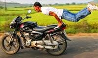 Man Pulls Yoga Poses On Speeding Bike