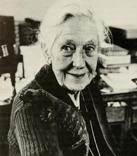 Doris Holmes Blake at her desk with her pet lizard on her shoulder