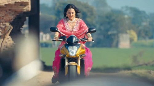 Sonakshi Sinha riding bike in pink kurta in SOS