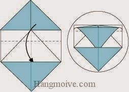 Bước 6: Gấp cạnh giấy xuống dưới vào trong khe giữa hai lớp giấy.