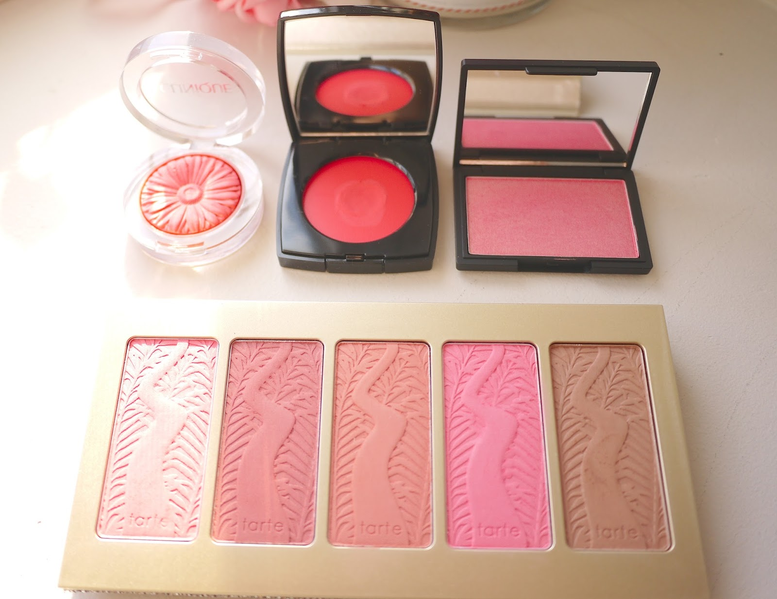 sleek rose gold blush, tarte off the cuff palette, chanel intonation blush, clinique peach pop blush swatches