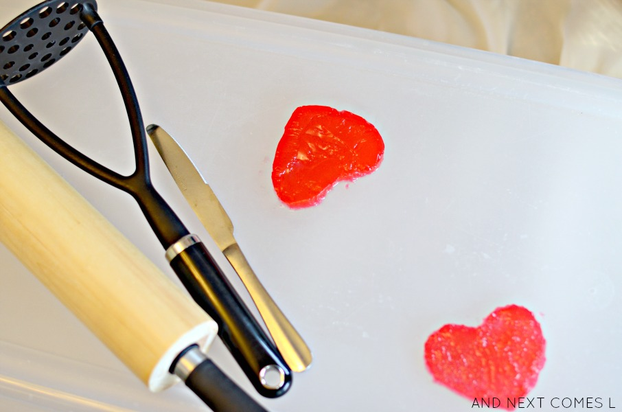 Gelatin heart-breaking sensory play for Valentine's Day from And Next Comes L