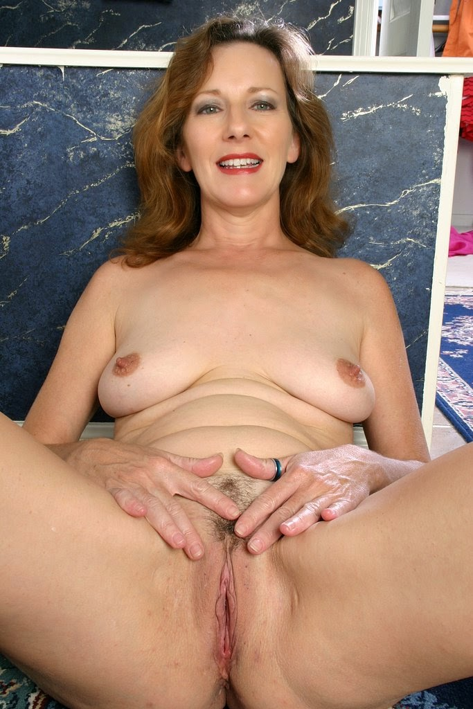 happy mature nude woman