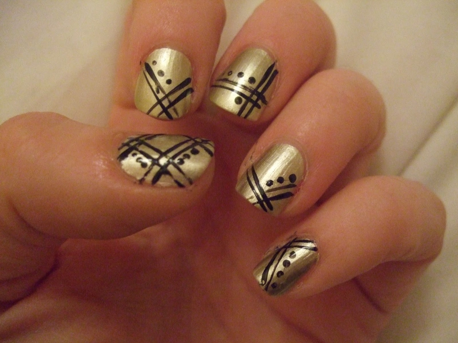 ... nail design is another quick and easy one! Its a gold Art Deco design