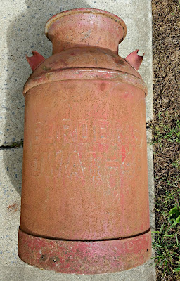 milk can labeled 48