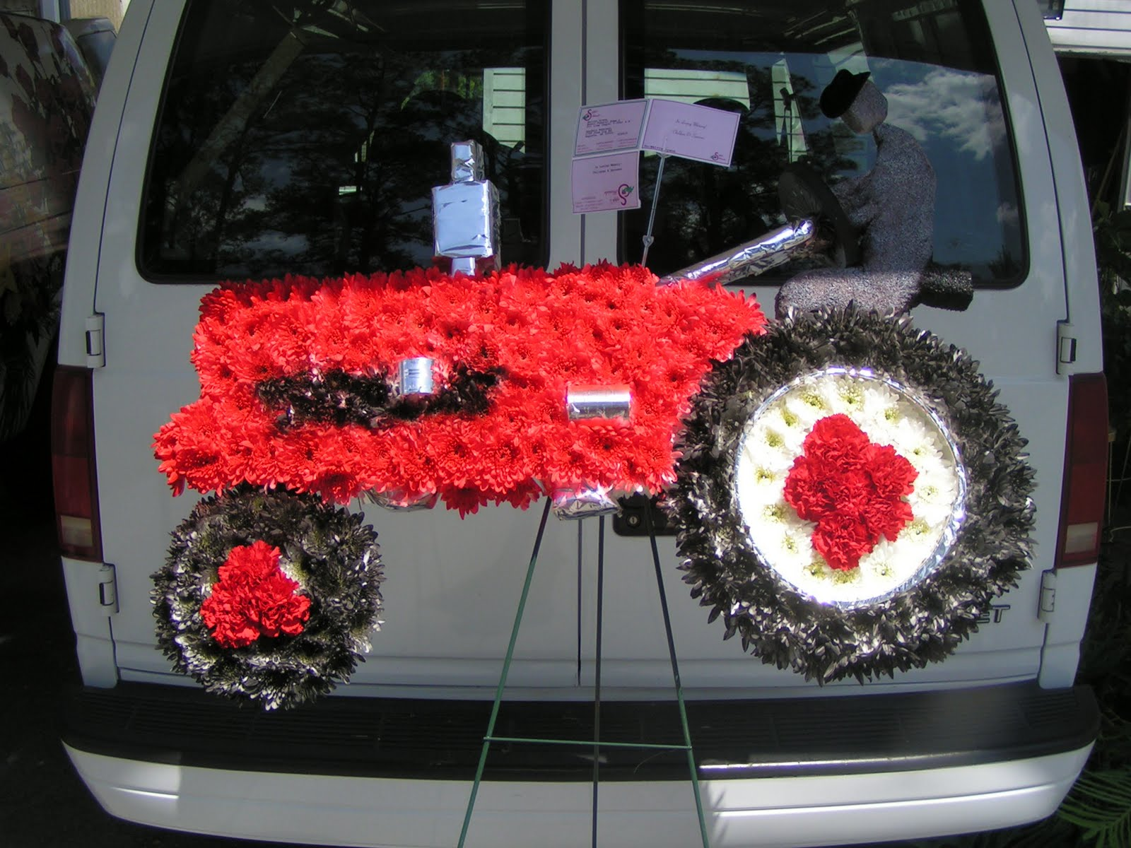 Sapps florist most unique designs of the day red tractor made of it at your funeral service family members are comforted by remembering the things we enjoyed most in life why not place a remembrance that reminds you izmirmasajfo