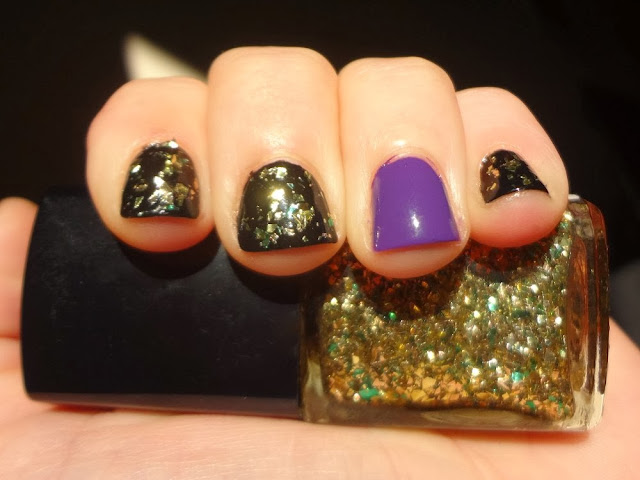 Black nails with gold and green flakes, purple accent nail, halloween nails