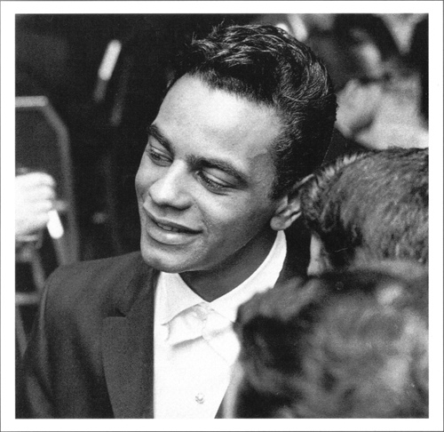 Openly gay singer Johnny Mathis was a star athlete at George Washington High ...