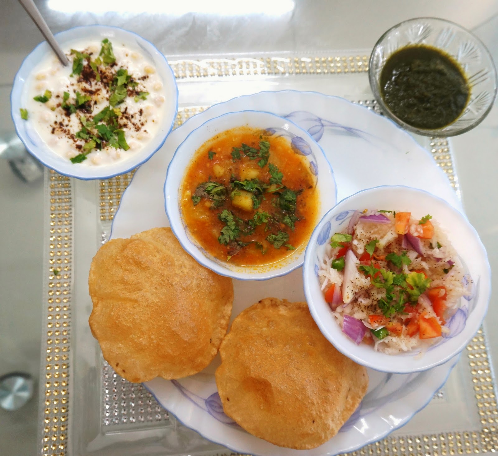 Aloo Poori/Puri with raita,salad and mint chutney