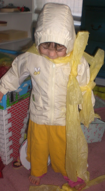 My little lucky star, dressed all in yellow with tissue paper.