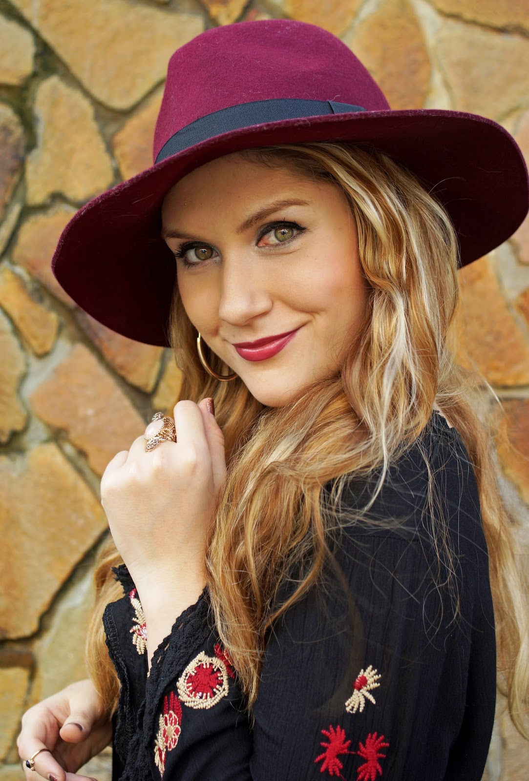 A floppy hat is the perfect accessory for a boho chic outfit!