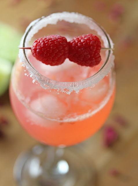 Close up view of Gin Rickey in a serving glass with raspberry garnish
