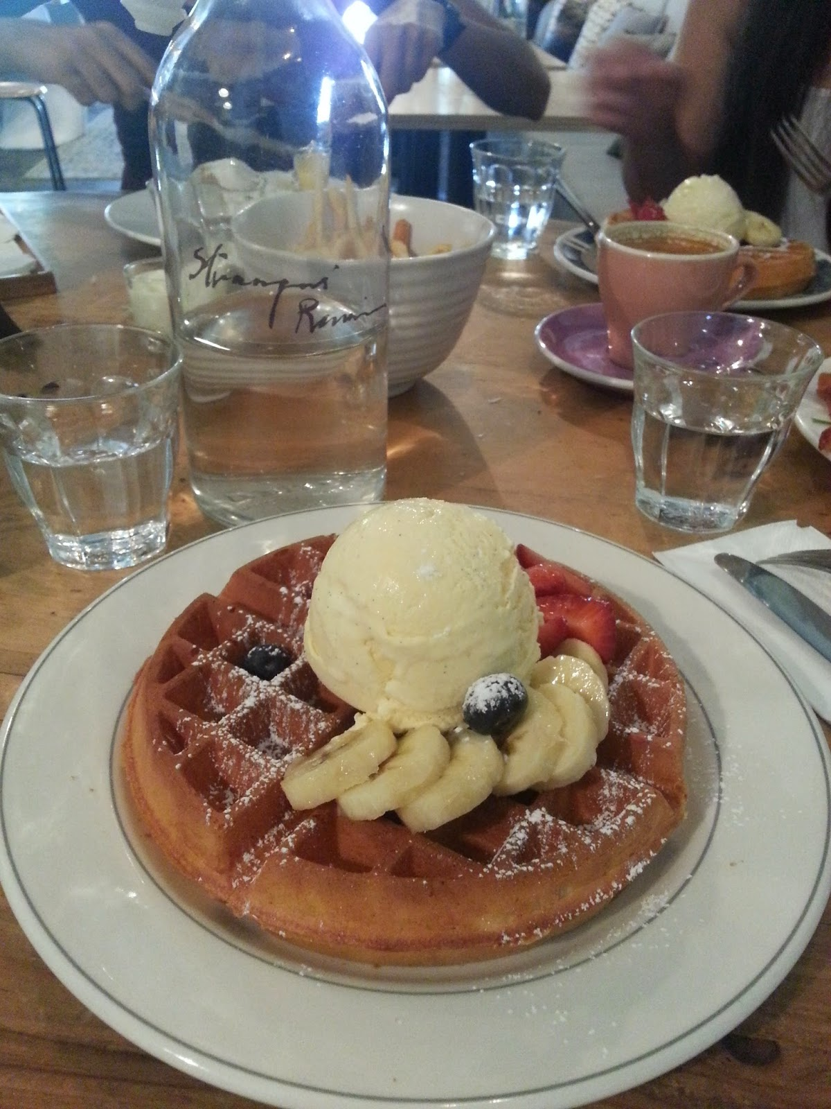 Strangers' Reunion buttermilk waffles with fresh fruits and vanilla bean ice cream